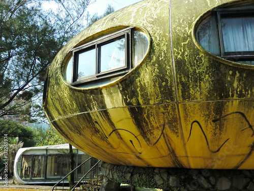 In de dag UFO Abandoned UFO round yellow houses in Wanli, Taiwan futuristic village