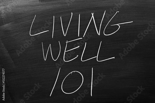 "Poster The words ""Living Well 101"" on a blackboard in chalk"