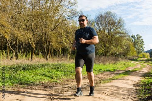 Fotobehang Hardlopen Big belly man jogging , exercising, doing.