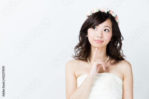 attractive asian woman wedding image on white background Poster
