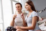 Joyful young couple drinking champagne