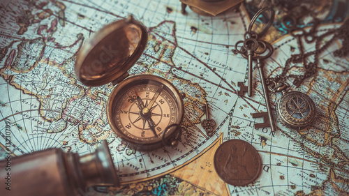 Fototapeta Old collection compass, telescope and collecting rare items on antique world map. (vintage style)