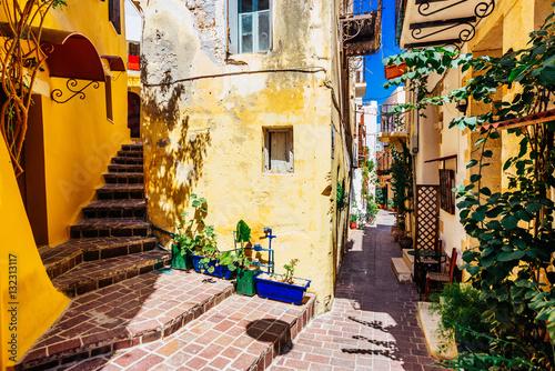 Zdjęcia na płótnie, fototapety na wymiar, obrazy na ścianę : Authentic narrow colorful mediterranean street in Cretan town of Chania, island of Crete, Greece