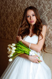 Bride in wedding dress at luxurious suites. Bride in a luxury apartment in a wedding dress.