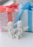 two angels in love against the background of  gifts.