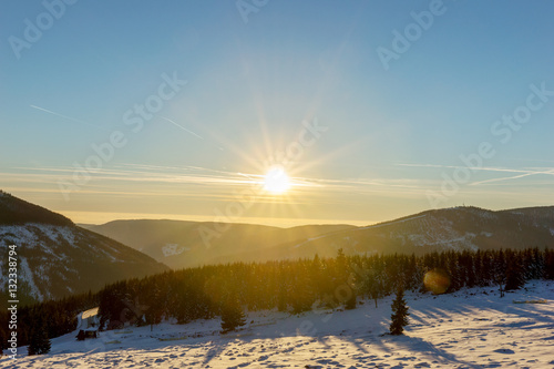 Fotografiet Beautiful winter sunrise with lens flare in Giant mountains, Czech Republic