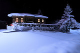 Old wooden house with a light in the window. Night landscape in winter - 132356313