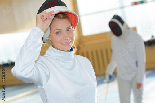 Poster Portrait of woman in fencing suit