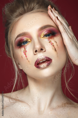 Poszter Beautiful woman portrait on wine background with colorful make up and shine tears om cheeks