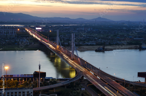 Poster City at dusk, aerial view of the bridge.