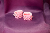pink handcuffs with thorns lie on a table