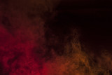 Red smoke in a dark room. Texture, background  - 132436548
