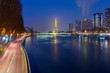 Panoramic Paris cityscape with Eiffel tower, quay de Grenelle and its reflection in the river Seine at night, as seen from bridge Pont Mirabeau, France