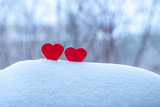 two beautiful hearts on a winter background - 132450961