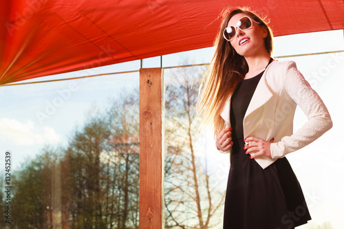 Poszter Young fashionable woman posing during sunny day.