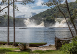 Ffalls in the lagoon of Canaima national park and tourist boat - Venezuela