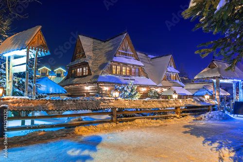 Wooden architecture of Zakopane at snowy night, Poland