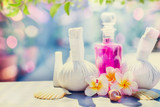 Spa and massage setting with frangipany flowers for Healthy treatments at spring or summer nature background
