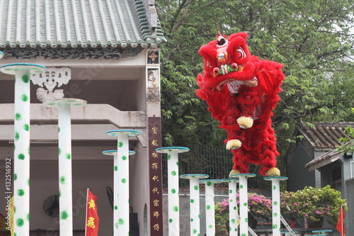 Red chinese Traditional lion dancing performance in new year celebration festiva Poster