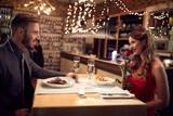 Romantic couple have dinner in restaurant