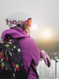 Girl in a ski resort. The woman snowboarder in the mountains. Snow, winter, mountain, snowboarding, skiing.