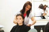 Woman getting hair cut in a beauty salon