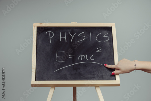 Physics word and formula E=mc2 on chalkboard Canvas Print