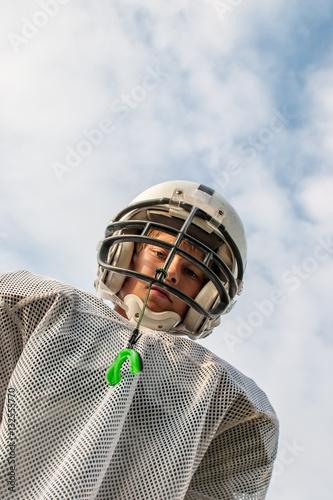 Fotobehang Voetbal Young boy in football uniform