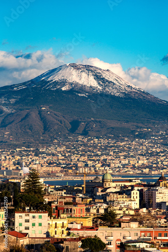 Fotobehang Napels Aerial view of Naples with Vesuvius mount with snow on the backg
