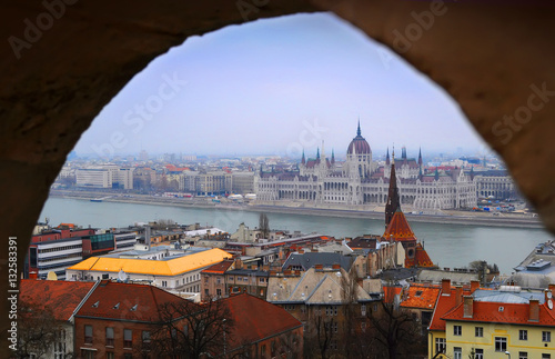 Poster View on the Parliament of Budapest, river Danube and nearby houses on a winter d