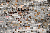 Vintage wall mosaic with neutral tone rough cut tiles