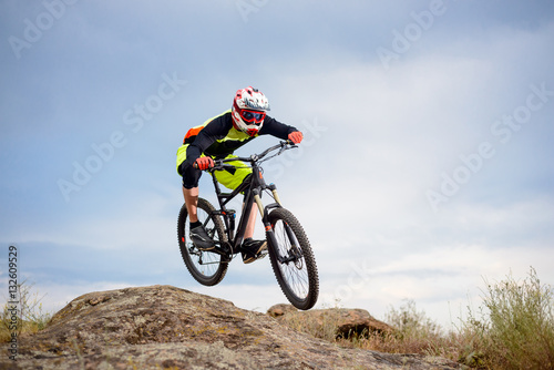 Poster Professional Cyclist Riding the Bike Down Rocky Hill