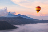 beautiful inspirational landscape with hot air balloon flying in the sky, travel destination - 132615726