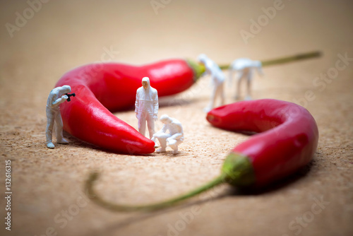 Foto op Aluminium Hot chili peppers Team of criminalists inspecting red chili peppers