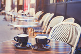 street cafe in Europe, two cups of coffee on cozy vintage terrace - 132620916