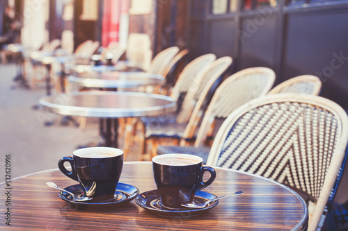 Poster street cafe in Europe, two cups of coffee on cozy vintage terrace