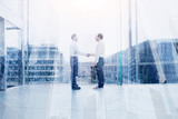 business deal or cooperation concept, two businessman handshake