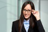 Businesswoman holding her glasses