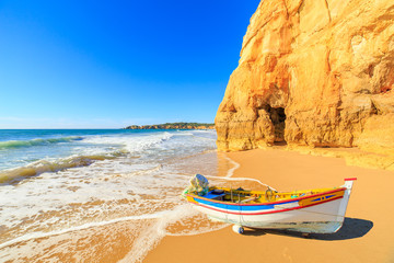 Fishing boat on a Praia da Rocha in Portimao, Algarve region, Portugal