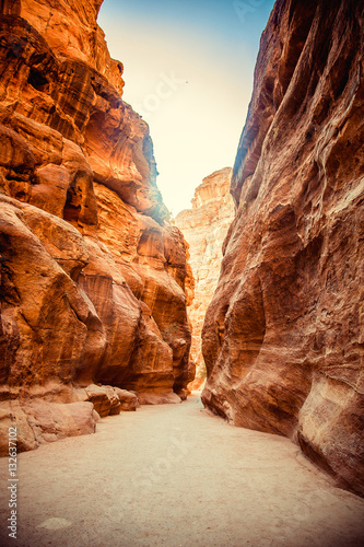 Main entrance to ancient city of Petra through the gorge rocks Poster