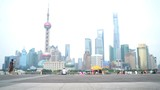 Woman running in city of Shanghai, China on famous boardwalk with skyline. Urban city lifestyle. Active Asian woman exercising outside jogging on the Bund.