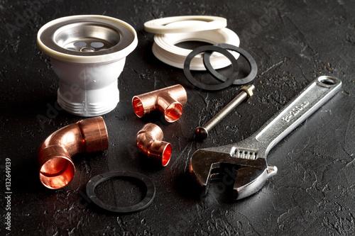 Plagát, Obraz concept plumbing tools on dark background