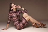 Fototapety Fashion portrait of young elegant woman in studio.