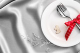 red heart shape with White empty plate with fork and spoon