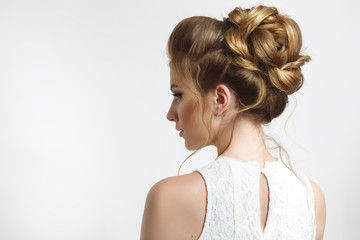 Elegant wedding hairstyle on a beautiful bride in profile. © ksi
