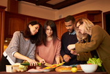 Group of multi ethnic young friends in kitchen prepare for party