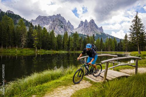 Poster Mountain biking in the Dolomites, Misurina, Italy. Tre Cime di L
