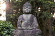 Old stone Buddha  - statue at a park