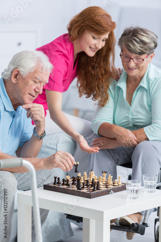 Poster Couple playing chess in nursing home