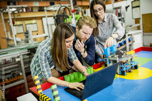 Young people in robotics classroom